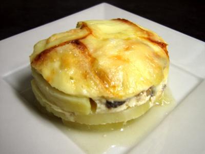 Cuisine suisse : Portion de pomme de terre à la raclette